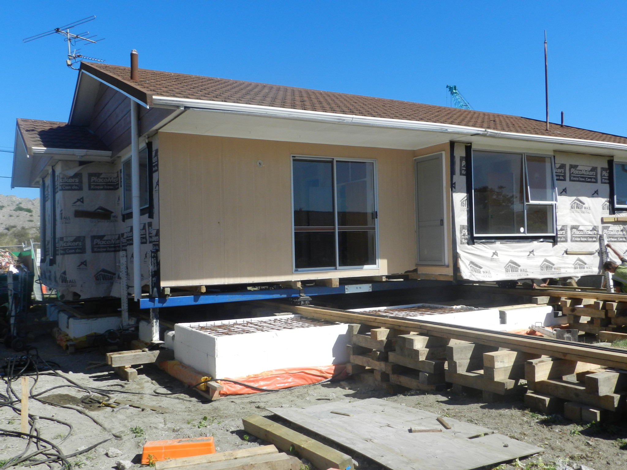 Moving a house across a property using house rolling methods in Christchurch